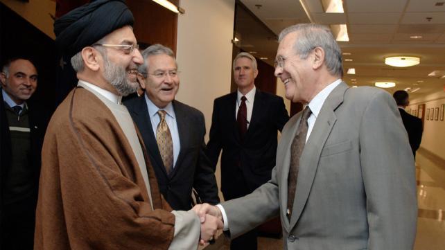 Secretary of Defense Donald H. Rumsfeld greets Sayid Abd al-Aziz al-Hakim