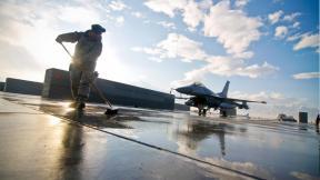 Sweeping up debris at Bagram Air Base, Afghanistan