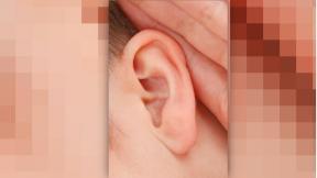 closeup of ear listening